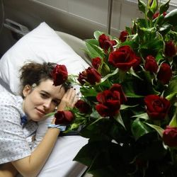 Jess in hospital with roses in Beirut