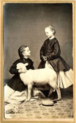 A LITTLE WHITE LAMB, A CHILD AND A CHINESE SERVANT