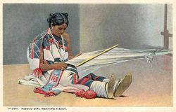 Indian Woman Weaving A Blanket