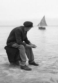 A Woman Awaiting A Sailboat