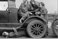 A Garage Man Testing A Car's Battery