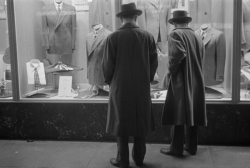 A Young Couple Window Shopping men looking in store windows
