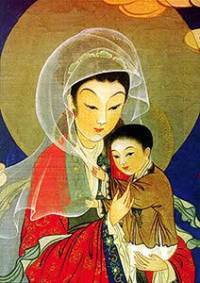A Chinese Woman Nursing A Baby